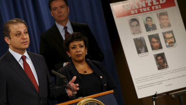 Manhattan U.S. Attorney Preet Bharara (L-R), Federal Bureau of Investigation Director James Comey and U.S. Attorney General Loretta Lynch hold a news conference to announce indictments on Iranian hackers for a coordinated campaign of cyber attacks in 2012 and 2013 on several U.S. banks and a New York dam, at the Justice Department in Washington March 24, 2016 - Sputnik International