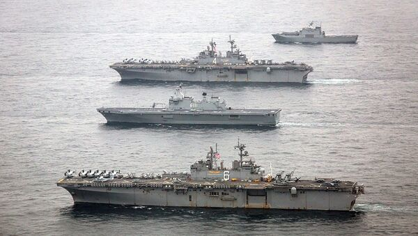 The U.S. Navy amphibious assault ships USS Bonhomme Richard, bottom, and USS Boxer, second from top, are underway with the Republic of Korea Navy Dokdo Amphibious Ready Group in the East Sea during exercise Ssang Yong 2016, March 8, 2016 - Sputnik International