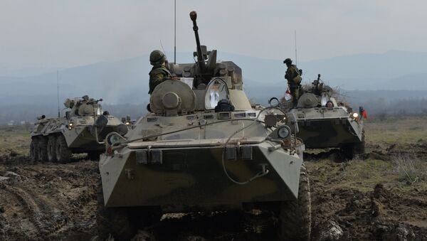 A file photo showing BTR-82A armored vehicles during the battalion tactical field firing exercise - Sputnik International