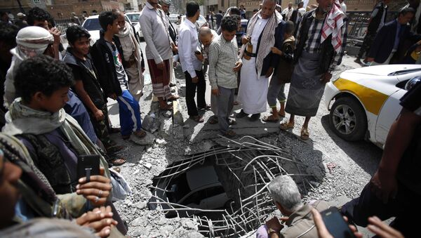 People stand around damages made by a Saudi-led airstrike on a bridge in Sanaa, Yemen, Wednesday, March 23, 2016. Yemen has been left fragmented by war pitting Shiite Houthi rebels and military units loyal to a former president against a US-backed, Saudi-led coalition supporting the internationally recognized government. - Sputnik International