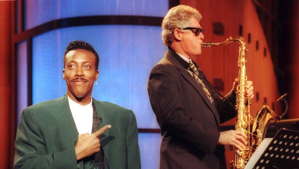 FILE - In this June 3, 1992 file photo, Arkansas Gov. Bill Clinton, plays the saxophone as host Arsenio Hall stands by during a campaign stop on The Arsenio Hall Show in Los Angeles. After two decades, Hall is returning to late night television with The Arsenio Hall Show, premiering on Sept. 9. - Sputnik International