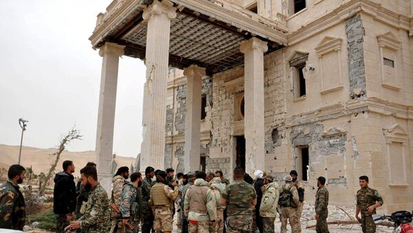 Forces loyal to Syria's President Bashar al-Assad gather at a palace complex on the western edge of Palmyra in this picture provided by SANA on March 24, 2016. - Sputnik International