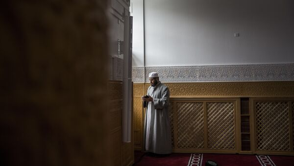 A man is pictured on 19 June 2014 during the official opening of Denmark's first mosque with a dome and minaret in Rovsingsgade, in Copenhagen's gritty northwest, after receiving a 150 million kroner (20.1 million euro, $27.2 million) endowment from Qatar. - Sputnik International