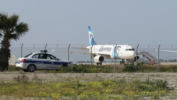 An EgyptAir Airbus A-320 sits on the tarmac of Larnaca airport after it was hijacked and diverted to Cyprus on March 29, 2016 - Sputnik International