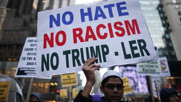 A Muslim youth holds a poster during a protest against Donald Trump on December 20, 2015 in New York - Sputnik International