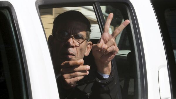 A man named Seif Eldin Mustafa, who was arrested after he hijacked an EgyptAir flight, which was forced to land in Cyprus on Tuesday, gestures as he is transferred by Cypriot police from a court in the city of Larnaca, Cyprus March 30, 2016. - Sputnik International
