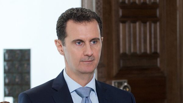 Syrian President Bashar al-Assad during an interview with Rossiya Segodnya Director General Dmitry Kiselev - Sputnik International
