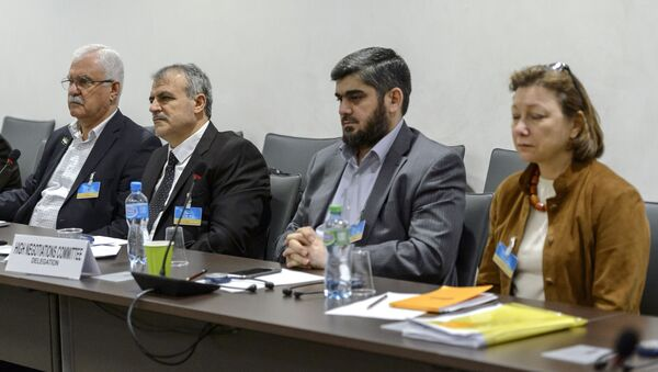 (From L) George Sabra and Asaad Al-Zoubi, of the delegation of the High Negotiations Committee (HNC), Mohamed Alloush of the Jaysh al Islam and Bassma Kodmani of the delegation of the HNC take part in a round of negotiations between representatives of the Internal Damascus Platform and United Nations on March 23, 2016 - Sputnik International