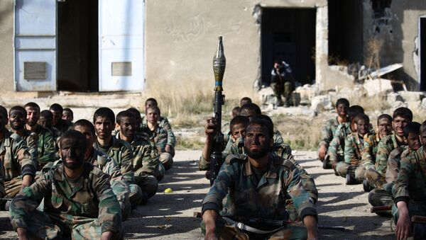 Syrian youths take part in their last training on December 8, 2014 before being sent to the frontline along with rebel fighters from the Jaysh al-Islam brigades (Army of Islam) in Eastern al-Ghouta, a rebel-held region outside the capital Damascus - Sputnik International