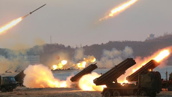 Multiple rocket launchers are seen being fired during a military drill at an unknown location, in this undated photo released by North Korea's Korean Central News Agency (KCNA) on March 25, 2016 - Sputnik International
