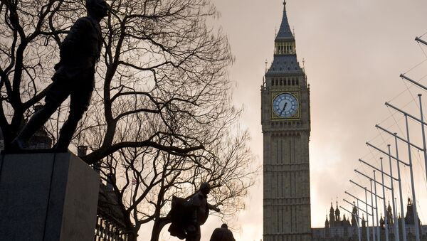 The sun rises behind The Elizabeth Tower, also known as 'Big Ben' on the day British Chancellor of the Exchequer George Osborne delivers his budget in London on March 16, 2016 - Sputnik International