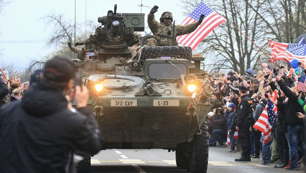US military convoy, including IAV Strykers, arrives to the Czech army barracks on March 30, 2015 in Prague after entering the Czech Republic at the border crossing in Harrachov on the way from Baltic countries to base in Vilseck, southern Germany - Sputnik International