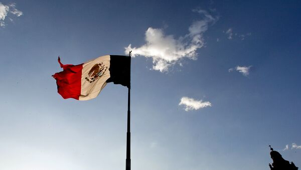 A Mexican flag flutters at the Zocalo square in Mexico City, on April 29, 2009. The World Health Organisation raised its flu alert to phase five out of six, WHO chief Margaret Chan said, signalling that a pandemic was imminent following the swine flu outbreak. - Sputnik International