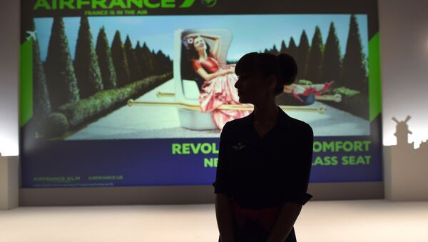 An Air France flight attendant looks at a screen at the new Air France Exhibition called Air France,france is in the Air - Sputnik International