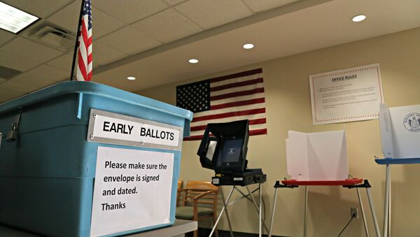 An example of an early ballot collection box and demonstration of voting areas is set up at the Maricopa County Recorder's office in Phoenix. - Sputnik International