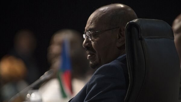 Sudanese President Omar al-Bashir attends the opening session of the AU summit in Johannesburg, Sunday, June 14, 2015 - Sputnik International