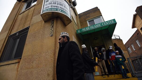 Muslims leave after participating in their weekly Friday noon special prayer at the Al-Islah Islamic Center Mosque in Hamtramck, Michigan, on January 8, 2016 - Sputnik International