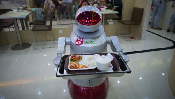 This photo taken on August 13, 2014, shows a robot carrying food to customers in a restaurant in Kunshan. It's more teatime than Terminator -- a restaurant in China is electrifying customers by using more than a dozen robots to cook and deliver food - Sputnik International