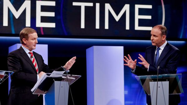 Irish Prime Minister and Fine Gael leader Enda Kenny (L) and Fianna Fail party leader Micheal Martin participate in the final televised leaders' debate in Dublin on February 23, 2016, - Sputnik International