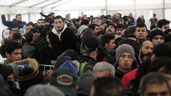 Hundreds of migrants waits in a tent to continue their registration process at the central registration center for refugees and asylum seekers LaGeSo (Landesamt fuer Gesundheit und Soziales - State Office for Health and Social Affairs) in Berlin (File) - Sputnik International