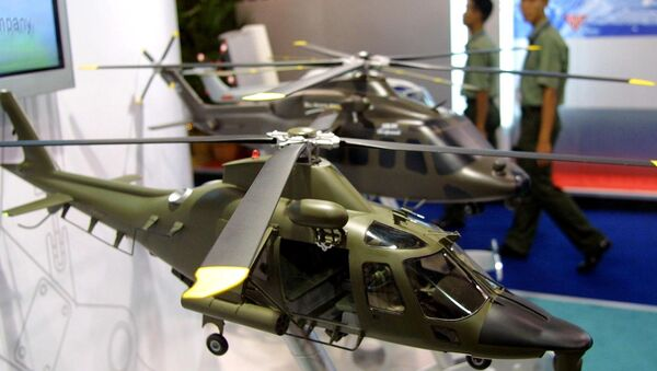 Army personnels walk past models of combat helicopters on display at the Defense Services Asia exhibition in Kuala Lumpur. (File) - Sputnik International
