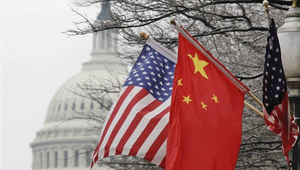 The Capitol dome is seen at rear as Chinese and U.S. flags are displayed in Washington, Tuesday, Jan. 18, 2011 - Sputnik International