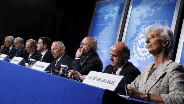 Gurria, Padoan, Osborne, Schaeuble, Sapin, Guindos and Lagarde hold a news conference at the IMF/World Bank Spring Meetings in Washington - Sputnik International