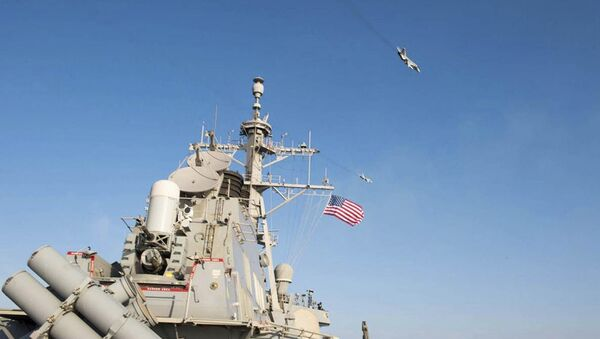 An U.S. Navy picture shows what appears to be a Russian Sukhoi SU-24 attack aircraft flying over the U.S. guided missile destroyer USS Donald Cook in the Baltic Sea in this picture taken April 12, 2016 and released April 13, 2016 - Sputnik International