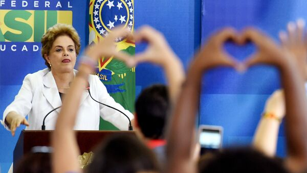 Brazilian President Dilma Rousseff gestures during the Education in Defense of Democracy event, at the Planalto Palace in Brasilia, on April 12, 2016 - Sputnik International