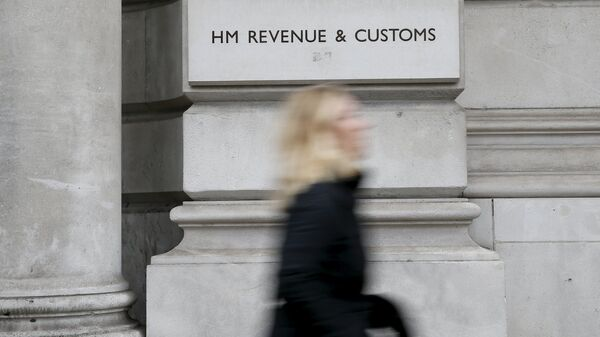 A pedestrian walks past the headquarters of Her Majesty's Revenue and Customs (HMRC) in central London, Britain in this February 13, 2015 file photo - Sputnik International