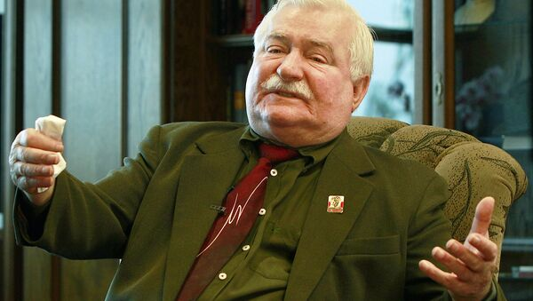 """Poland's former president and legendary Solidarity freedom movement founder Lech Walesa acts with expression as he repeats his denials to allegations he collaborated with the communist regime and talks about the """"crisis of democracy"""" during an exclusive interview with The Associated Press at his new office at the European Solidarity Center in Gdansk, Poland, Wednesday, April 6, 2016 - Sputnik International"""