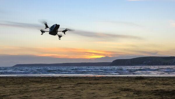 A drone overflies a beach - Sputnik International