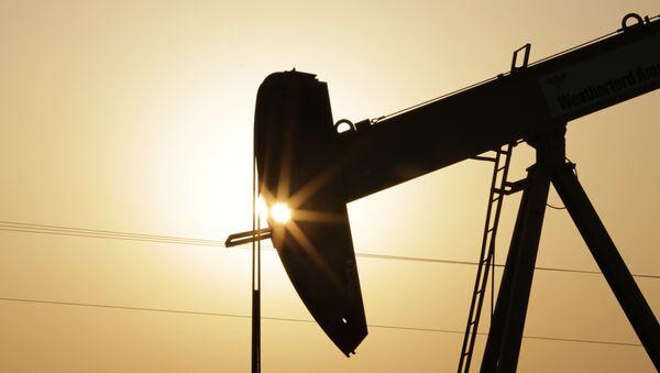An oil pump works at sunset Wednesday, Sept. 30, 2015, in the desert oil fields of Sakhir, Bahrain - Sputnik International