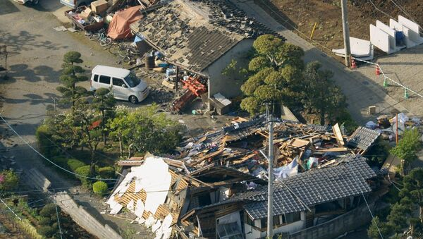 Collapsed houses caused by an earthquake are seen in Mashiki town, Kumamoto prefecture, southern Japan, in this photo taken by Kyodo April 15, 2016 - Sputnik International