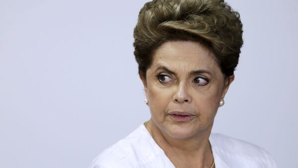 Brazil's President Dilma Rousseff looks on during signing of federal land transfer agreement for the government of the state of Amapa at Planalto Palace in Brasilia, Brazil, April 15, 2016 - Sputnik International