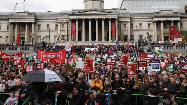 Protesters with placards and banners demonstrating on a variety of domestic issues including a call for British Prime Minister David Cameron to stand down, organised by the People's Assembly Against Austerity, listen to speeches in Trafalgar Square after marching in central London on April 16, 2016. - Sputnik International