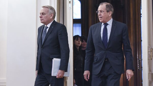 Russian Foreign Minister Sergei Lavrov and French Foreign Minister Jean-Marc Ayrault during a meeting in Moscow - Sputnik International