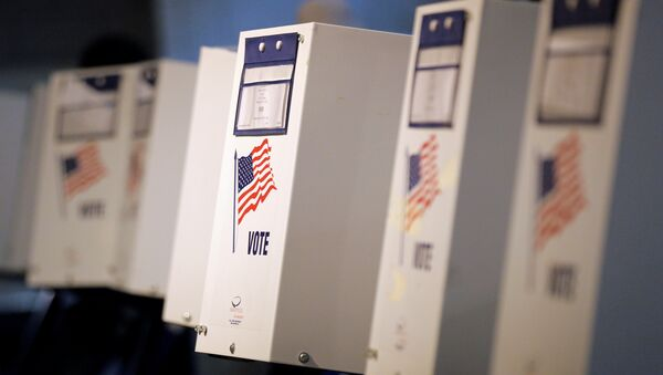 Voting booths are seen during the New York primary elections at a polling station in the Brooklyn borough of New York City, U.S., April 19, 2016. - Sputnik International