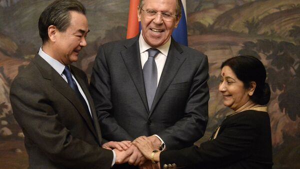 From left: Chinese Foreign Minister Wang Yi, Russian Foreign Minister Sergei Lavrov and Indian Foreign Minister Sushma Swaraj during are photographed before a plenary meeting of the foreign ministers of Russia, India and China (RIC) in the Reception House of the Russian Foreign Ministry. - Sputnik International