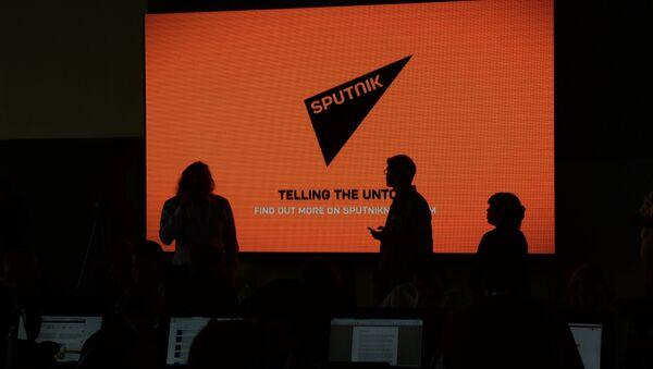 A screen with the logo of the Sputnik international news agency and radio - Sputnik International