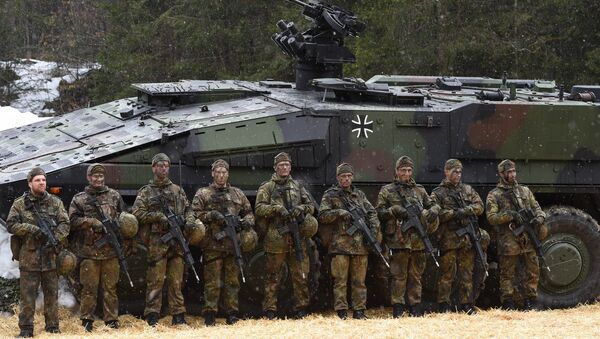 Mountain infantry soldiers stand in front of a troops transporter Boxer after an exercise of the mountain infantry brigade 23 of the German Bundeswehr near the Bavarian village Bad Reichenhall, southern Germany, on March 23, 2016 - Sputnik International