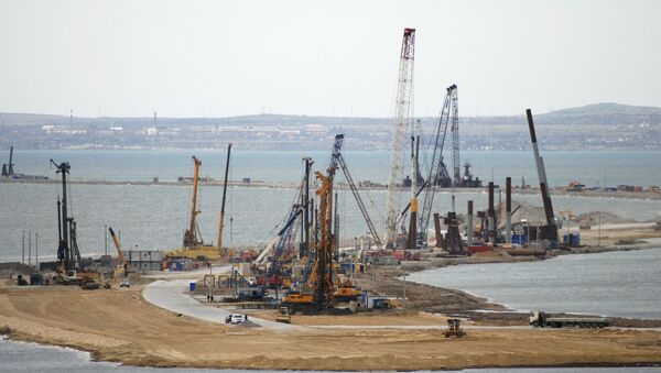 The construction of a bridge across the Kerch Strait to Crimea is seen from the outskirts of the Taman settlement in Krasnodar region, southern Russia, April 4, 2016 - Sputnik International