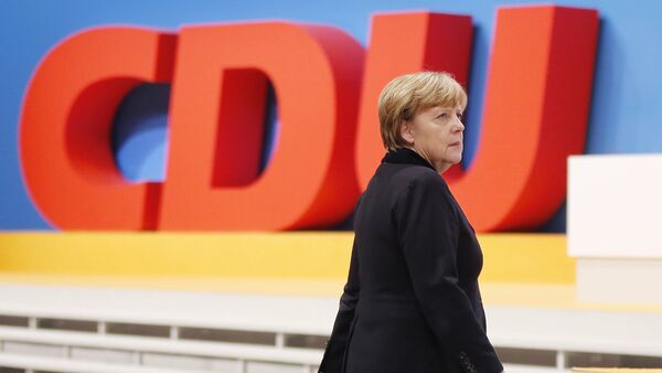 German Chancellor Angela Merkel walks past the party logo during a party convention of the Christian Democrats (CDU) in Karlsruhe, Germany, December 14, 2015. - Sputnik International