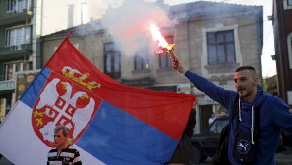 A supporter of Radical Party lights a flare before pre-election rally in Jagodina, Serbia (File) - Sputnik International