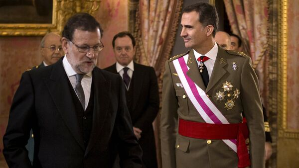 In this Wednesday, Jan. 6, 2016 file photo, Spain's King Felipe VI walks with Spain's Prime Minister Mariano Rajoy, left, during the annual Pascua Militar Epiphany ceremony at the Royal Palace in Madrid, Spain - Sputnik International