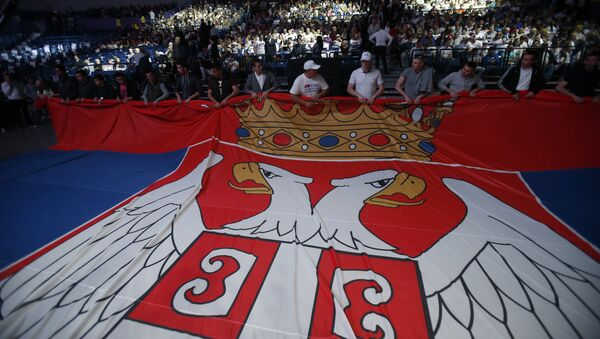 Serbian Progressive Party supporters hold Serbian flag during a pre-election rally in Belgrade, Serbia, Thursday, April 21, 2016 - Sputnik International