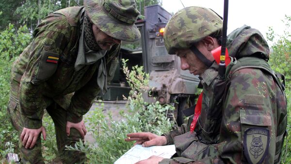 Lithuanian soldiers take part in a field training exercise, file. - Sputnik International