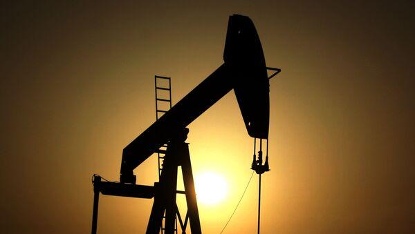 In this Wednesday, June 8, 2011 file photo, sun sets behind an oil pump in the desert oil fields of Sakhir, Bahrain - Sputnik International