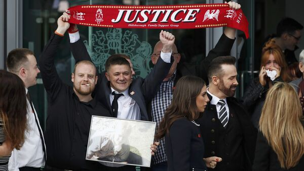Relatives react after the jury delivered its verdict at the new inquests into the Hillsborough disaster, in Warrington, Britain April 26, 2016. - Sputnik International