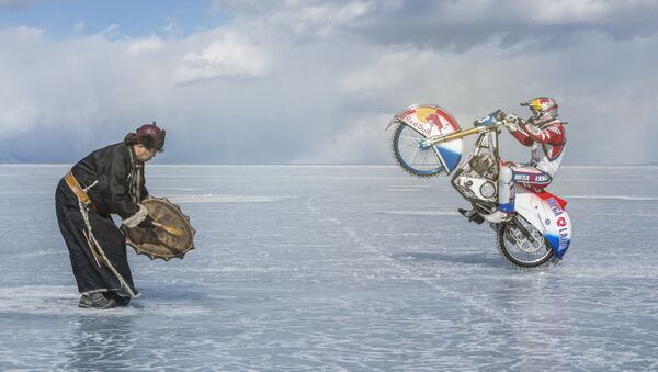 When faced with the danger of falling through the thin ice of Lake Baikal, moto racer Daniil Ivanov asked for the help of a local shaman to bless his risky endeavor. - Sputnik International